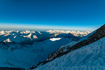 The shadow of Everest stretches to the western horizon at sunrise from near the South Summit on the Southeast Ridge of Mount Everest on May 18, 2009.