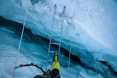 Crossing a crevasse in the Khumbu Icefall, Mount Everest, Nepal.