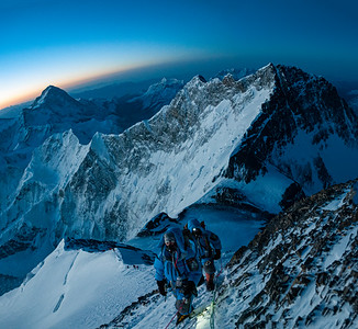 Climbing toward the South Summit of Everest with Lhotse and Makalu behind. The Balcony can be seen below the climbers.