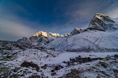 Pumori towers above Gorak Shep, the highest settlement in the Khumbu. Kala Pattar rises as the black hill below Pumori, with Chumbu on the left.