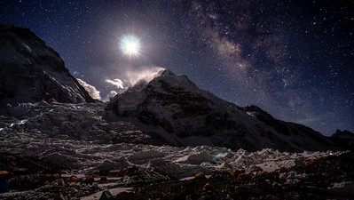 A full moon and the Milky Way rising over Khumbu Basecamp and the Khumbu Icefall on Mount Everest, Nepal.