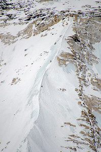 Gerlinde Kaltenbrunner and David Göttler descending from the summit of Nuptse after climbing the North Ridge-Scott route on May 17, 2012. Amazingly, this photo was taken by me - alone with David Morton on the West Ridge Headwall - of two climbers alone on Nuptse, while across the valley 250+ climbers stood in a conga line making their way from Camp 3 to Camp 4 on the Lhotse Face of Everest. Different worlds.
