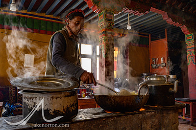 A Tibetan man cooks noodles and butter tea at Rongbuk Monastery, Tibet.