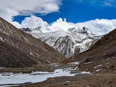 "Shuguang Ri (21,725 ft / 6,622 m) from high in a valley east of Rongbuk Basecamp on Mount Everest, Tibet. In Mandarin, Shuguan means ""dawn;"" the mountain is unclimbed."