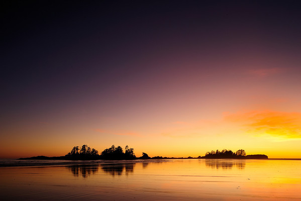 Chesterman Beach Spectacular - The beach at low tide extends for a long distance exposing the wet sand that just captures this magnificent sunset. Chesterman Beach is located on Vancouver Island not far from the small town of Tofino.
