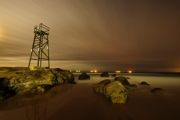 Night Watch - Redhead Shark Tower - It was almost full moon, but then a bit of cloud cover came over. The distant lights are the coal ships waiting to be loaded at the Newcastle Port.