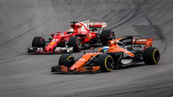 Fernando Alonso (Car 14 - MCL32 - McLaren Honda) & Sebastian Vettel (Car 5 - SF70H - Scuderia Ferrari)