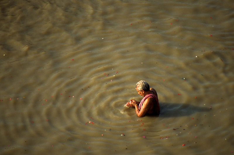 Ripple / A worshiper performing ablutions in the sacred river / The Ganges River, Varanasi, India