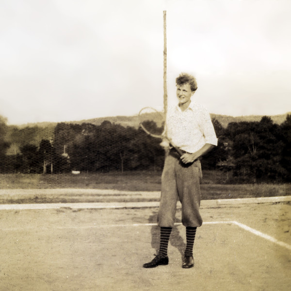 John Jr. playing tennis on the court he helped build - 1930