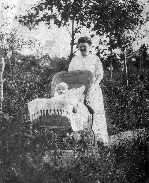 John Huber Jr. in carriage with mother Edmunde - 1914