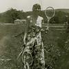 Muriel holding tennis rackets - 1930