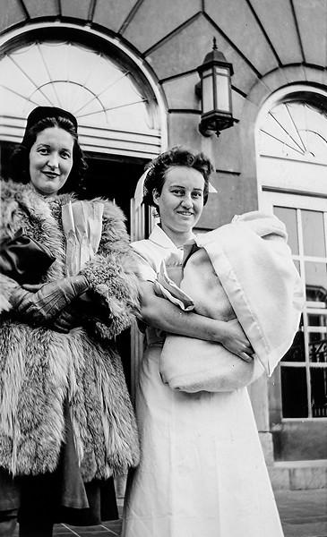Mom & nurse leaving hospital with Robert - December 1943