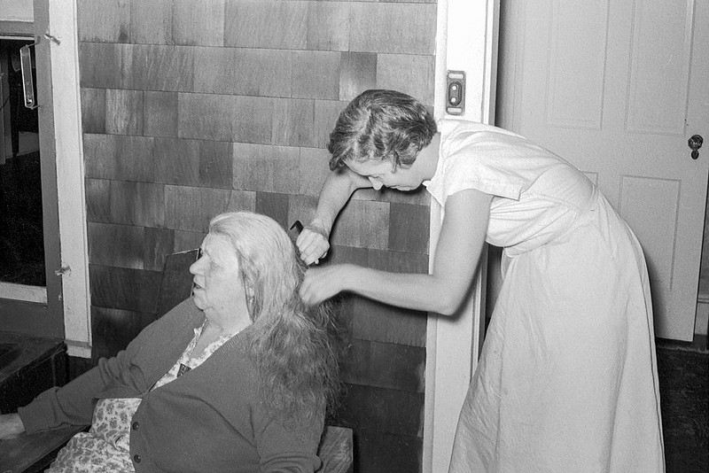 Mom combing out Grandma's hair - 1953