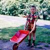 Greg with toy wheel barrow - June 1952