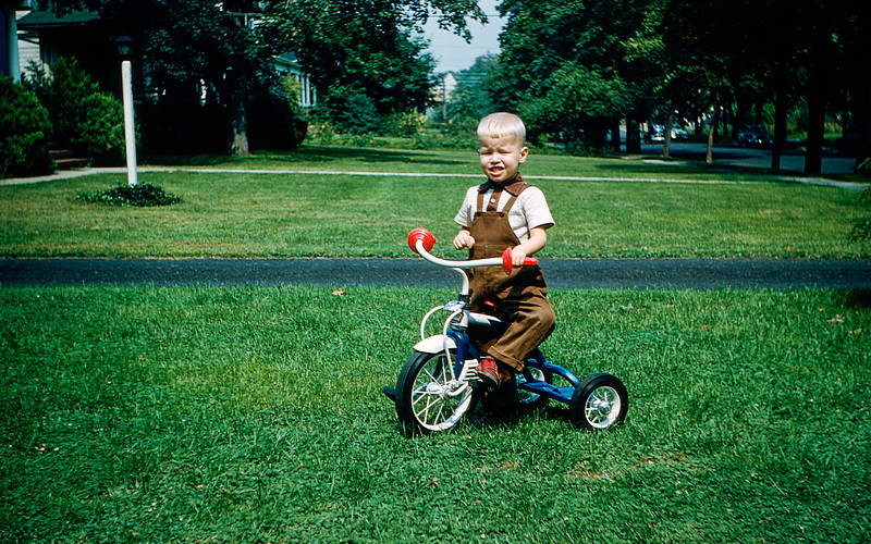 Barry on his tricycle a gift for his 3rd birthday - 1955