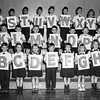 Greg holding the 'W' - Top row 4th from right