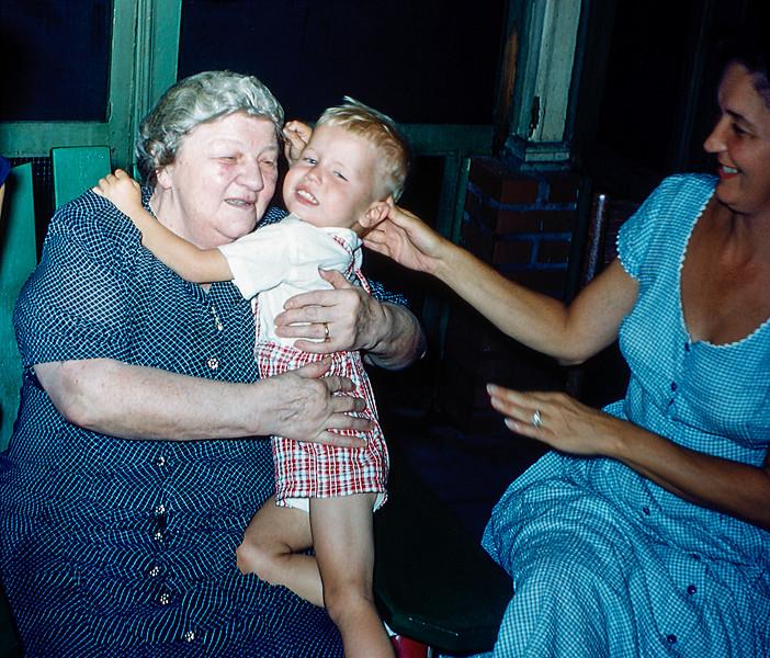 Grandma's birthday hug from Barry with Mom - 1955
