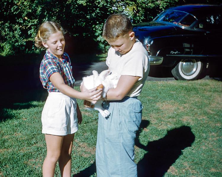 Helen & Robert feeding Hoppie  - September 1955