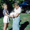 Helen & Robert feeding Hoppie  - September 1955