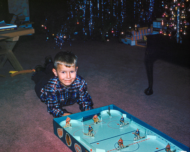 Barry playing with his hockey game - Christmas 1958