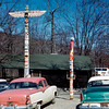 Camp No-Be-Bo-Sco totem poles - March 1959