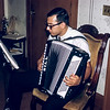 Bill playing his accordian at the 25th anniversary party