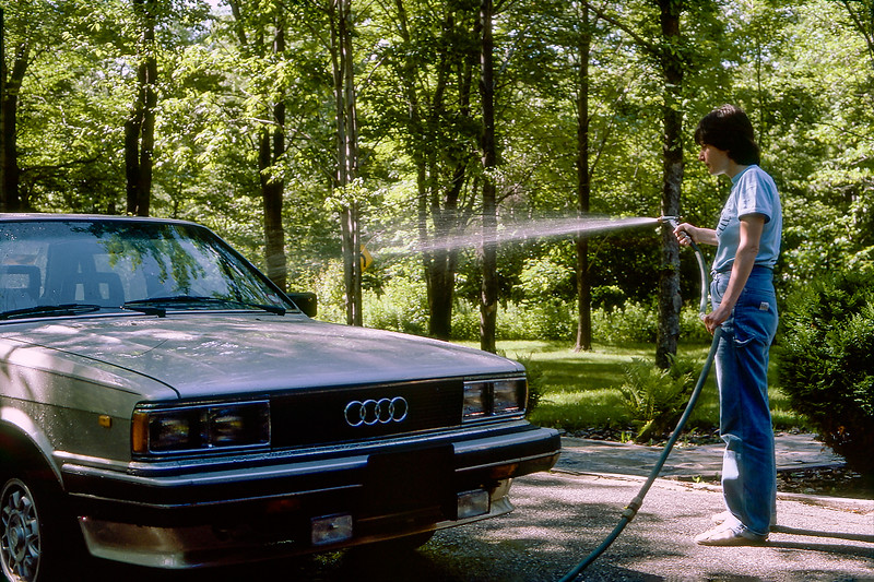 Mercedes washing her new Audi 4000s - 1984