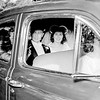 John Jr. & Rita in car after their wedding ceremony