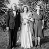Rita with her parents on her wedding day