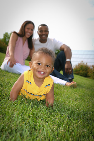 Happy smiling Boy Playing Outddor with Parents In Summer Sunny Day