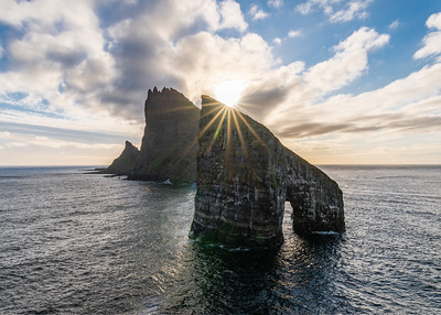 Sunburst over Drangarnir, Faroe Islands
