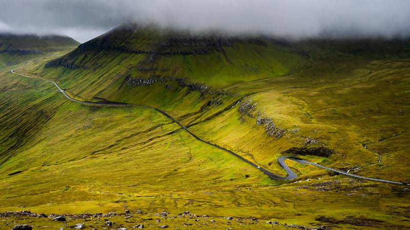 Winding road in mist and rain, Faroe Islands