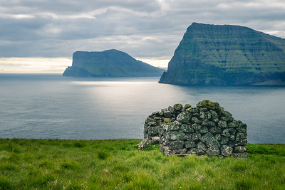 The Faroe Islands are separated by long, narrow fjords.  An old sheepherders hut.  I am reediting photos from last summer.