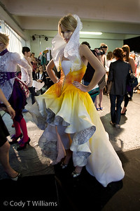 Graduating students of the ESMOD international fashion school, also known as l'Ecole Supérieur des arts et techniques de la Mode, prepare backstage before their final exam presentation in the Turenne Garage in Paris, France June 4, 2009. /© Cody Williams.