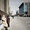 Morning of the inauguration, people wander the streets or rest from their long walks.