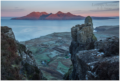first sunlight on the mountains of Rhum, from neighbouring Eigg