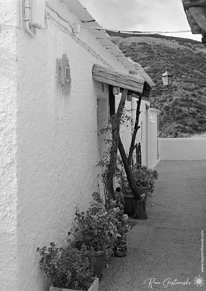 Capileira - The entrance porch to a white house in the village