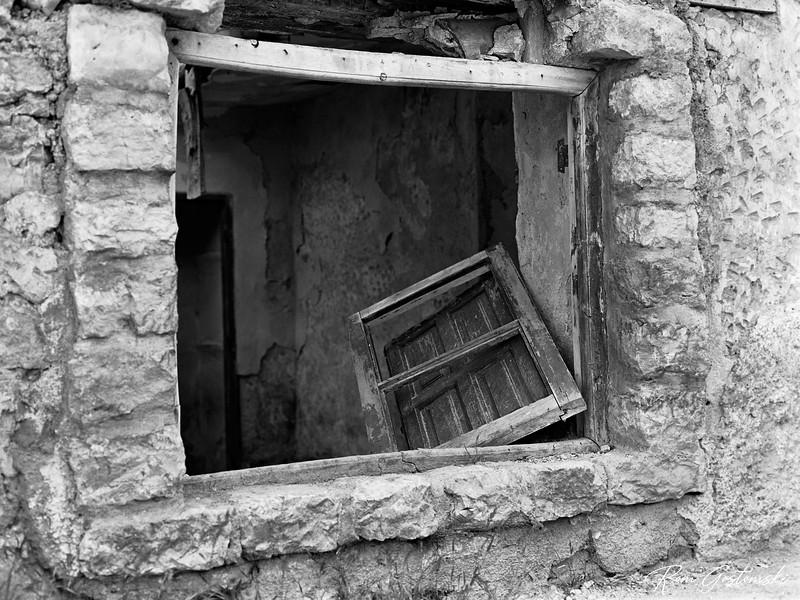 Abandoned cortijo - an old shuttered window