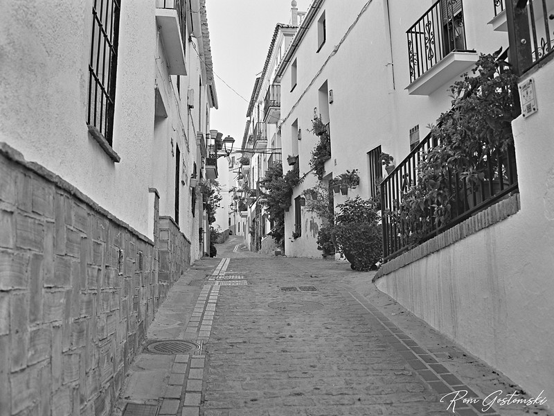 Steep narrow cobbled street in Jubrique