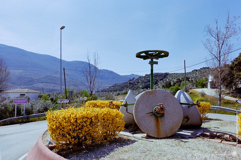 Olive mill stones on a roundabout