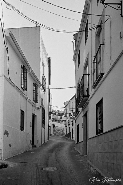 One of the narrow streets in Carchelejo with decorations for the