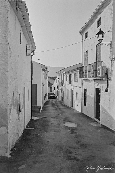 Sweeping up. A street in Carchelejo