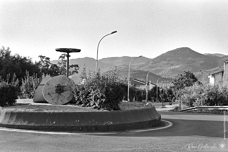Olive crushing stones on a roundabout
