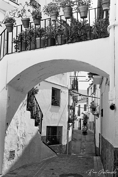 This arch over a narrow street in Jubrique is the entrance to a