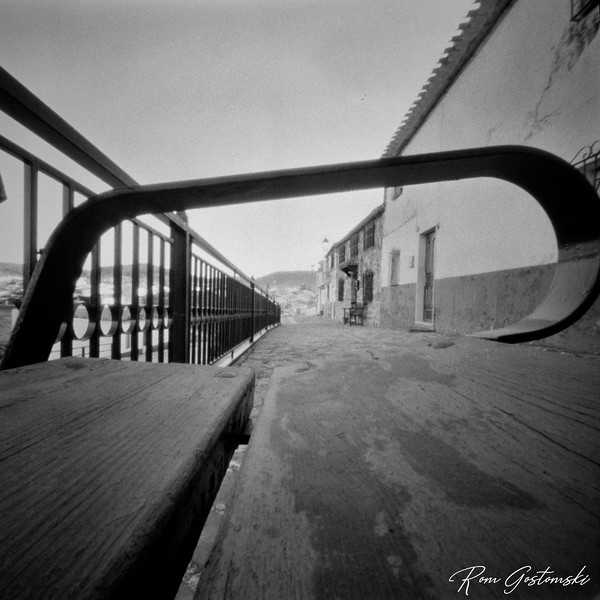 Through the pinhole: Looking through a bench arm-rest