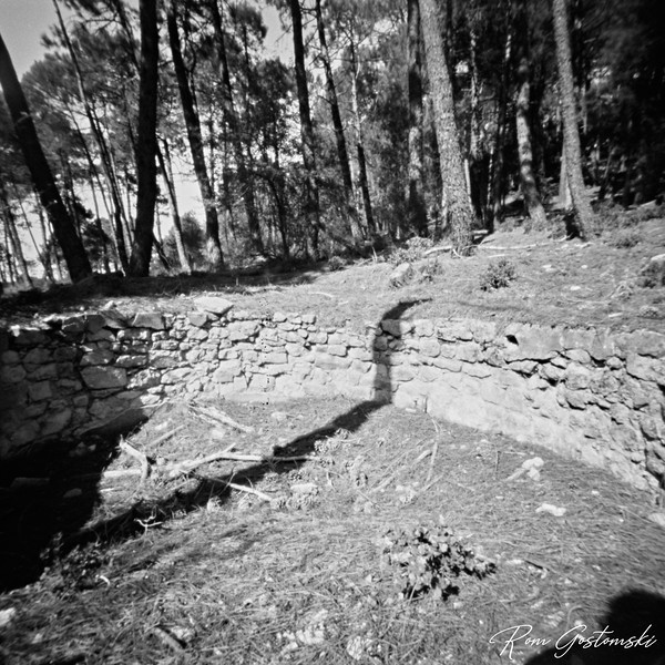 Through the pinhole - stone wall in the forest