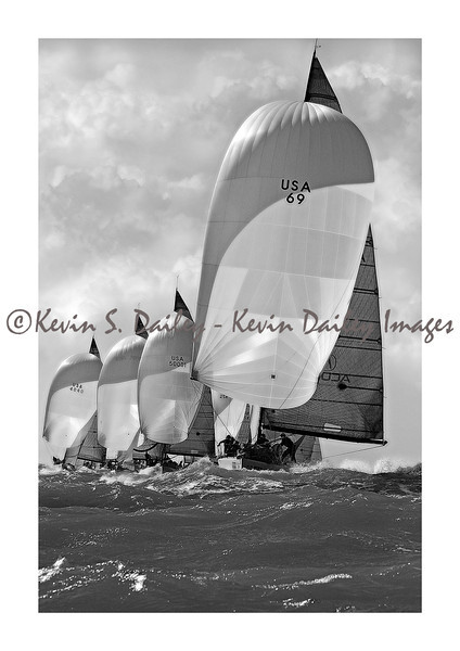 The boat is the Farr 40 #69 'Warpath' in waters off Key West, FL, during Key West Race Week.<br /> Kevin describes the scene: 'Warpath was charging downwind in 20 plus knots of wind. Awesome action with the boats behind lined up perfectly. The following year this boat won the North American Championship.'