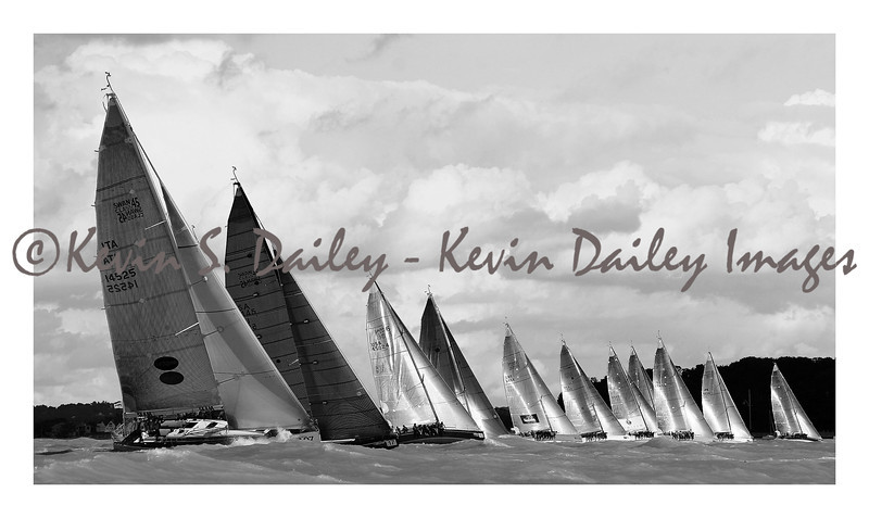 The boats: Swan 45s, shot off Key West, FL, during Key West Race Week.<br /> A picture perfect line up of the fleet with light and dark sails shimmering in beautiful contrast to one another.
