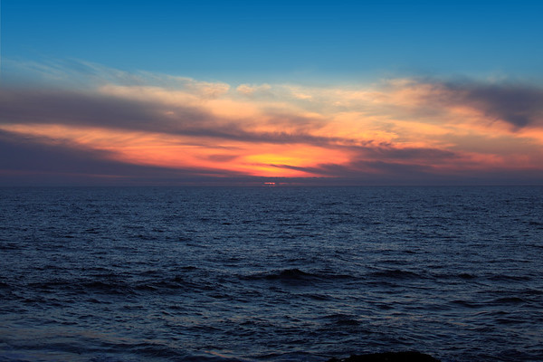 Blue to Blue. Ocean blue transitions to sky blue through the fiery orange of an Oregon coast sunset.