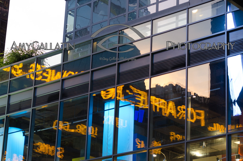 Scrolling Ticker Tape Reflecting off building